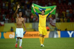 "On the right, the Tahiti goal keeper Mickael Roche, with the Brazilian flag. ""Thank you Brazil, you made us dream."""