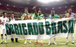 """Thank you Brazil"". The Tahitian team holding a thank you banner after their final game in the competition."